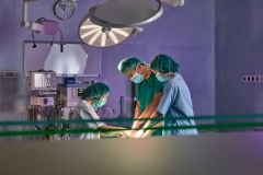 Group of surgeons in operating room,