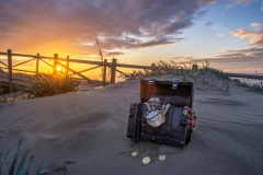 treasure chest at the beach in a sunrise