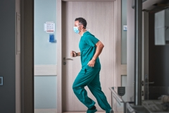 male doctor running in hallway